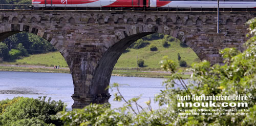 A southbound Virgin train crosses the Royal Border Bridge at Berwick