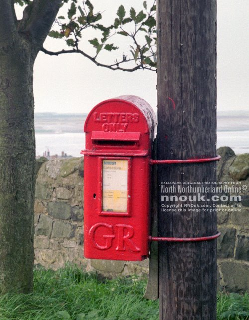 Royal Mail postbox near Kiln Point overlooking Budle Bay, Northumberland