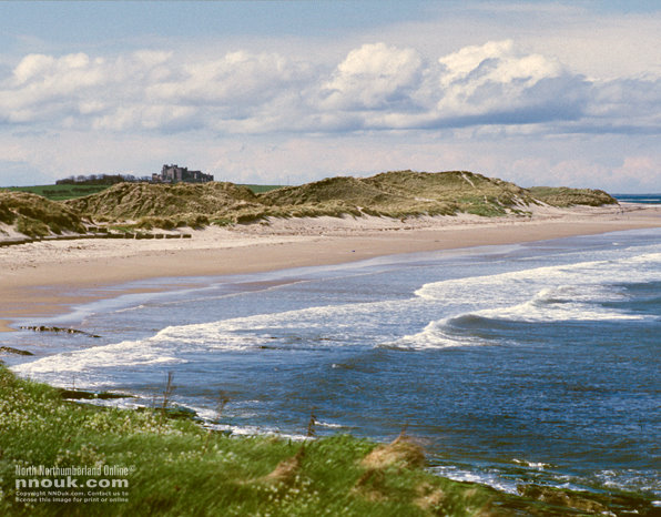 The Beach North Of Seahouses Bamburgh Castle Is In Distance