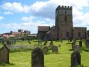 St. Aidan's Church and the castle, Bamburgh, Northumberland